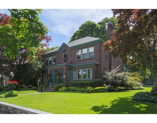 Stately brick single in the Bellevue Hill area. Sited on corner lot with beautiful grounds, 4 bdrm, 2 bath home welcomes you into a glassed-in, sun filled outer entry. Interior foyer w/ classic spaces, hdwd flooring & traditional detail (picture molding etc). Fire-placed living room with bench seat under four panel windows. Adjacent music room overlooks 1 of 2 patios. If naturally lighted space is what you seek, this is your home! 38 windows, double or triple glazed Pella. Classic dining room with a beveled glass door into a generously 'cabineted' white kitchen. Terrazzo-floored family room with wall of windows, gas fired Jotul stove & dining counter. Direct access to sizable 2 car garage and 2nd garden patio. 3 of the bdrms have 4 windows each! 2nd floor also has a full bath. Meticulously maintained! Mostly unfinished basement has laundry area, storage and a small lav. Gas fired forced hot water heat, central air. …and it's all downhill to the nearby commuter rail, Roche Bros & shops.
