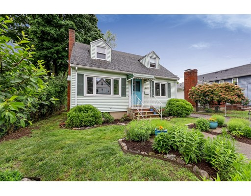 Wonderful true Cape-Cod style home nestled in the Greenbelt of Hyde Park, with access to Turtle Pond, Smith Field and all of Stonybrook Reservation, yet a 10-minute walk to Cleary Square and the commuter rail to downtown Boston!  Surrounded by a front garden filled with native pollinators (no watering!) and a spacious backyard framed by mature trees and shrubs, plus a large back patio.  Inside, hardwood floors throughout and a renovated country kitchen with butcher-block counters and work island, stainless LG bottom-freezer fridge, sparkling farmer's sink and ingenious hand-made shelves.  Nicely renovated half bath off the kitchen plus an indispensable mudroom.  The living room features a wood-burning fireplace and opens to a playroom/family room.  Upstairs, 3 generous bedrooms with lots of closet space and a nicely updated bath.  Tons of storage in the eaves and full basement.  2014 HW and new LG washer, too!
