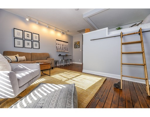 Millhaus Loft! Sun-filled studio in a converted mill building. Trendy design aesthetic that makes incredible use of space. Lofted bed space is accessed with Quiet Glide library ladder and sits above a large closet outfitted with shelving and rack space. Kitchen space has white cabinets and full size appliances including dishwasher and exterior venting microwave.  Bathroom is classic B&W tile with walk-in show with glass enclosure and rain head. Living space is well outfitted with TV, fold out table, floating shelves, Nest Thermostat, freshly painted throughout, new LED lighting throughout living areas, recently refinished rustic stained wood floors, central air. Located in the heart of Mansfield Center just steps to commuter rail (40 min to Boston, 28 min to Providence) and restaurants. Elevator bldg has in-ground pool, tennis courts, hoops 1/2 crt, park area w/stream & picnic area. On and Off Site Management, Low Condo Fee. Can be Sold Fully Furnished and Voice Controlled Smart Home.