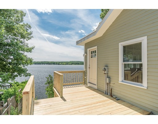 WATERFRONT on Lake Attitash!! Stunning condo alternative with private DOCK!  Complete renovation in 2018 - gorgeous cathedral ceiling living room with a wall of windows and AMAZING views of the Lake.  Sleek kitchen with white cabinets and granite countertops; beautiful pine flooring throughout and an updated bath with granite.  New windows, new furnace, new hot water heater, new deck and so much more!  Showings begin at first open house on Sunday, 6/23, 2pm-4pm.