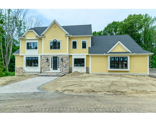 NEW CONSTRUCTION IN PREMIER ANDOVER LOCATION CLOSE TO PHILLIPS ACADEMY & PIKE SCHOOL! MASTER BUILDER, GREG ALEXANDRIS, OFFERS QUALITY CRAFTSMANSHIP & EXCEPTIONAL ARCHITECTURAL DETAIL! Beautiful level lot in desirable Andover location is the setting for this 5 bedroom beauty, which nestles into the landscape & offers tranquil, private setting close to downtown Andover. CUSTOM GOURMET KITCHEN w/walk-in pantry, 10' center island w/ breakfast bar, top-of-the-line stainless appliances leads to expansive cathedral ceiling family room w/ gas fireplace, db. French doors to oversized deck. Private 1st floor library. Gorgeous dining room w/picture window. LUXURIOUS MASTER SUITE, elegant & spacious, w/spectacular marble master bath & oversized walk-in closet. Four additional bedroom suites on 2nd floor. Dual staircases. Finished walkout lower level offers additional space for game room/exercise/media room w/ full bath. CUSTOM LUXURY HOME IN PRIME NEIGHBORHOOD, EXCELLENT HIGHWAY ACCESS TO BOSTON!