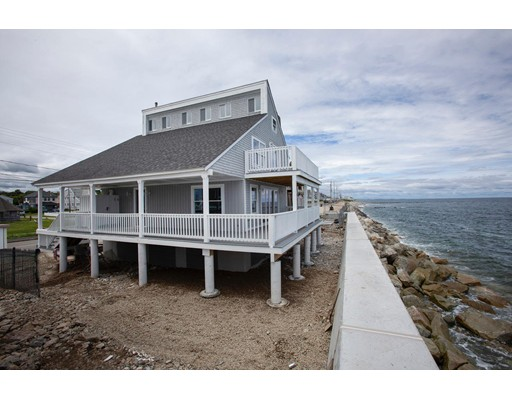 OPEN HOUSE SUNDAY AUG 25th 12-130p .Welcome to Oceans Edge, this custom built direct oceanfront home has been completely remodeled from top to bottom. This light & bright open floor plan is suitable for entertaining w/ fabulous oceanviews, new gourmet white kitchen, new stainless appliances, 2 new full baths, new flooring & doors, new fireplace,new gas furnace,new central air,new electric service,new plumbing,1st floor laundry& freshly painted interior. Exterior features include: new roof, new windows, new sliders, 2 expansive oceanfront decks w/panoramic oceanviews, new outdoor shower, freshly painted exterior and 2 car garage. This unique rare find oceanfront home sits behind a new 8.5 million dollar seawall & has been elevated to comply w/FEMA guidelines & is conveniently located just steps from Brant Rock Esplanade w/bars, restaurants & shops.Flood ins is $595 per yr per seller & grandfathered..Motivated Seller.