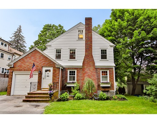 This 1930's colonial classic is full of charm and spacious surprises.  Lovely arched doorways, dental molding, and glass knobs are accentuated by warm oak flooring.  There is a formal living room with centered fireplace, a formal dining room with built in corner hutch, combined with a spacious kitchen and additional family room with access to back deck and yard, making the first floor great for entertaining and family living.  Three bedrooms with ample closet space and remodeled full bathroom are on the 2nd floor.  The walk up 3rd level is a large flexible space with skylight for guest room, kids play space or home office.  Newly remodeled lower level offers a bonus guest suite with full bathroom and separate laundry room, as well as ample storage.  Newly updated Pella windows, custom plantation shutters in the living room, landscaping with new grass, flower boxes, raised bed vegetable garden, and spacious yard make this home more than you ever expected.