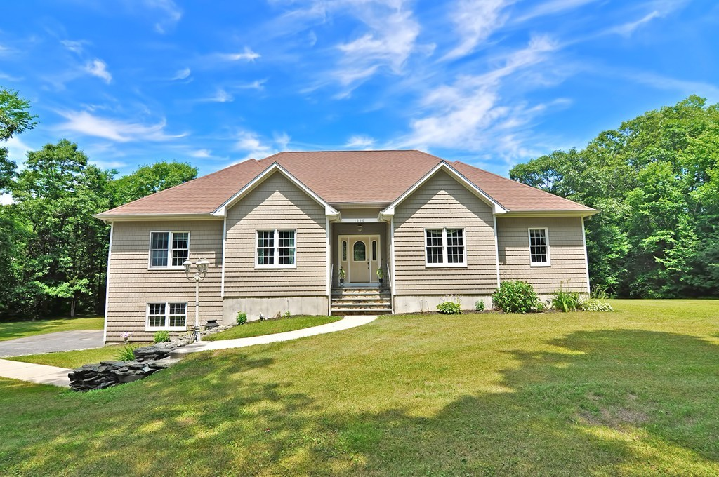 Welcome Home! Pride of ownership shines throughout this impeccably maintained expansive single level! Gleaming hardwood floors, sun filled eat in kitchen with granite countertops, cathedral ceiling living room with stone fireplace, formal dining room, office and laundry room. Three spacious bedrooms encompass one side of the home including a jaw dropping master suite. The lower level is a walkout and ready to be finished leading to a gorgeous tree lined one acre lot and attached two car garage. Nothing to do but move in!