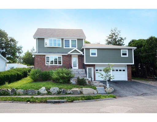 """Sought out neighborhood of North Medford! Exquisite Multi level home which has been re built in 2014!Offers entertainment space on 1st&LL levels. All 4 BRS located on 2nd&3rd levels for privacy! Rich walnut HW floors on entire 1st level, LR has a wood FRPLC which is1 of 3 FRPLCS ,recessed lighting, formal DR & classic granite kitchen w/center granite island w/ built in gas stove top ... perfect layout for open floor plan living at its best!  Master bedroom suite is"""" front to back"""" featuring gas  FRPLC along w/ recessed lighting.  MBR marble bath almost complete(to be completed by buyer )On that 3rd level is a home office w/ window.. just perfect ! The lower level completely finished w/ FRPLCD family room & 2 more additional rooms Use them as you need may I suggest: bedrooms, exercise whichever suite yours needs. Yard is customized from patio pavers TO A STONE BARBECUE PIT  Lower level is finished with FRPLCD FR & 2 more rooms not included in living space Additional approx 790 sq ft."""