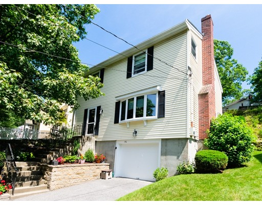 WELCOME HOME to this Chestnut Hill colonial tucked away on a picturesque tree-lined street.  Meticulously maintained by its current owner, this gem is located in a sought after West Roxbury neighborhood just steps to the Brookline border.  With just over 1600 square feet of living, 3 bedrooms, 1.5 baths, plus a bonus finished area in the basement...there is plenty of space to be had.  The oversized kitchen with gleaming hardwood floors and a large dining area is just waiting for your personal touch.  Sliders open up to a lovely back deck along with cozy outdoor space perfect for grilling or just relaxing.  3 good sized bedrooms upstairs, including a master bedroom with a nice sized walk-in closet outfitted with an Elfa closet system!  Heating system and hot water heater were replaced with Navien tankless in 2016.  Garage parking underneath along with one space in the driveway.