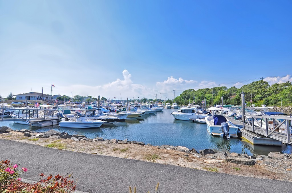 Attention Beach Lovers, Boaters, Fishermen! This home is a must see! A great home for a Family starting out or empty nesters looking to downsize and be close to the coast. With the Cape Cod Canal on one side and Marina across the street behind the house, this is a great location to have a boat or go fishing. This home has been well cared for and features many updates, such as a newer architectural roof, insulation, vinyl windows, vinyl siding, new floors, and a new private deck!. Located on a quiet, dead end street. A great first floor layout can accommodate single level living. This home is close to many amenities, yet feels very private and cozy. This home will qualify for all types of financing and is move-in ready!