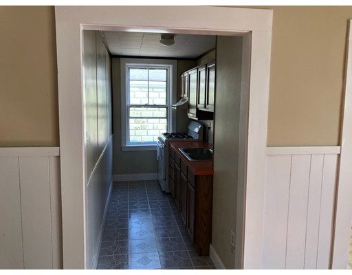 Beautifully renovated 1st floor apartment offers 4 spacious & sunny bedrooms, kitchen & dining/living combo! Brand new stove & refrigerator! Close to all area amenities including Brooklawn Park in the north end of New Bedford! Active landlords who take lots of pride in their property!