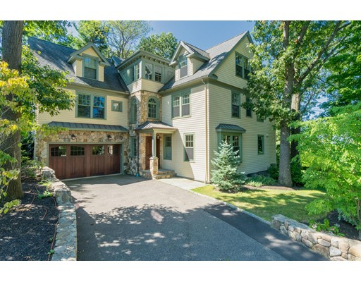 NEW PRICE! Prime Chestnut Hill. Extraordinary custom built Shingle & Stone tucked away at the end of a cul-de-sac w/ magnificent tree-top views. 6500+ sq.ft. home boasts stunning architectural detail w/ custom millwork & finest appointments. Sun-drenched 6 bedroom 6.5 bathroom home offers soaring ceilings, large picture windows & mahogany floors throughout. First fl. has custom kitchen w/ wood mode cabinetry, top of the line appliances & granite countertops. Elegant dining area w/coffered ceiling & skylight. Expansive livingrm w/ large picture windows overlooks the tranquil grounds & offers incredible sunset views. Music room or first fl. bdrm completes this level. 2nd fl, 4 generous sized bdrms including a luxurious master suite w/ tray ceiling, walk in closets, spa-like marble bathroom. Ensuite bdrm & 2 bdrms w/ shared bath complemented by sun-lit sitting area. Huge 3rd fl w/ 2 bds, east facing office. Finished walk-out ll. Min.to BC, short commute to Boston & Cambridge. 2 car ga
