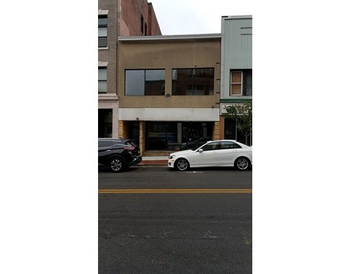 PERFECT DOWNTOWN LOCATION...If you are looking for a live/work property look no further.  1st floor office space/ retail etc.  2nd floor can be used as one large apartment or 2 small apartments for extra income as it is zoned residential.  Close to Bristol Community College and UMASS Dartmouth Campuses.  Just steps from the the New Bedford Hotel.  Updated electrical, and new AC.