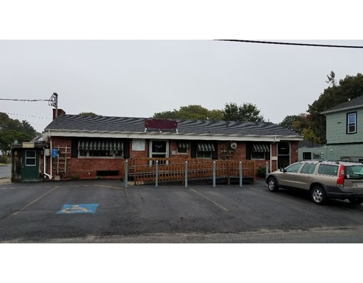 This property contains a long time, very successful Restaurant/Bar.  This property is just up the street from East Beach in a superior location.   There is an abutting Creamery Business with 2 apartments and an adjacent parking lot located across the street with 75 parking spaces.  These 3 properties can be combined as one sale.