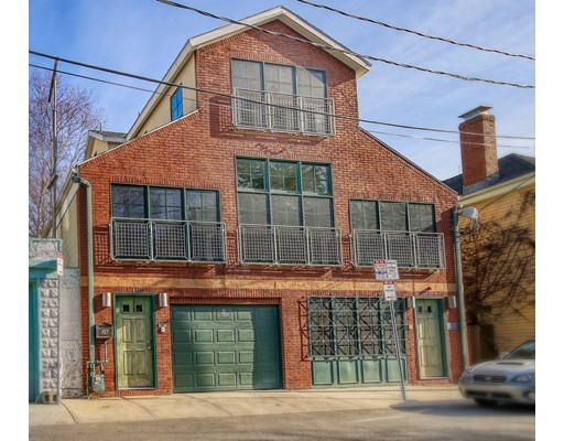 Large Kendall Square loft style single family home and only one owner since designed by acclaimed local architects Boyes-Watson and within steps to Kendall/Technology Square, Red Line and Green Line. This 4 bed, 4 full bath and 2 half bath home features soaring beamed ceilings in a warm welcoming environment flowing with natural light and ideal space for entertaining. 1st floor has space that could be used as au-pair suite or bonus family room along with en suite bedroom. 2nd level has open concept living with dining, living room, kitchen with granite counters, large island and stainless steel appliances, two en suite bedrooms and private deck access off living room and library. Upper level has a large beamed ceiling home office, master bedroom with beamed ceiling, deck, walk in closet and elegant bathroom with steam shower, tub and double vanity. Parking has direct home access and spacious for 3 vehicles and plenty of storage. Private showings only.