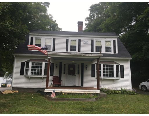 Rare combination of a refurbished historic home and commercial buildings located on a spacious 1.5-acre lot, minutes from downtown Ashland with easy access to the commuter rail.  Great opportunity to offset mortgage with rental income while living in a beautifully renovated 3 bed, 1 bath antique colonial with original architecture flowing together with modern upgrades. Aged pine floors in main part of house, working fireplace in updated kitchen, and newly finished barn turned family room with pellet stove.  Option to build an additional bathroom off the master bedroom.  Would also be perfect for a business owner who requires workshop space for equipment.  Potential development opportunity.  Buyer to do own due diligence.