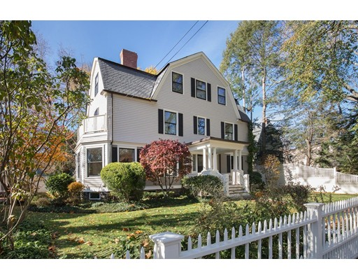 This immaculate 1890 Dutch Colonial combines old-world craftsmanship and chic modern updates in coveted West Cambridge. Flexible, sunny living spaces throughout with hardwood floors, millwork, tall ceilings and five fireplaces. From the dramatic entry, pocket doors reveal a formal living room and dining room, each with bay windows and fireplaces. Ahead, there's a powder room, a family room and a massive eat-in chef's kitchen. Above, the serene master suite is perfectly planned for two, with separate walk-in closets and en suite baths. Two generous bedrooms, laundry and a shared bath complete the level.    On the top floor, a vaulted great room is joined by two more beds and baths while the finished lower level includes a home gym, media room, bathroom and abundant storage. Outside, the manicured grounds feature tall mature trees, lawns, a patio and a detached garage. Located on a lovely tree-lined street just minutes from Harvard Square, the T, great shopping, dining and nightlife.