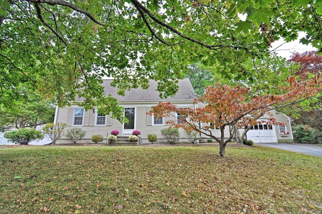 ***Multiple Bids-Highest & Best due by 3pm Saturday 10/5***  You won't want to miss this well-maintained 4-bedroom New England Cape Cod home, tucked inside a quiet neighborhood with attached garage. This home features 1 ½ bathrooms, laundry on the 1st floor and a bonus sun-drenched sitting room with a built-in bookshelf. The eat-in kitchen comes complete with beautiful wainscoting finish, granite countertops, stainless steel appliances, recessed lighting and a blissful view into an inviting, private backyard! Just off the kitchen is a sun-filled dining room with built-in hutch and chair rail. Stepping into the living room you'll find a fireplace with wonderfully detailed mantle, plantation shutters and crown molding for an extra nice touch! All the bedrooms are delightfully sizeable, featuring good size closets, especially the master with double closets. Note the half bath currently hosts the washer and dryer, however it is plumbed if one wanted to add an additional shower to the home.