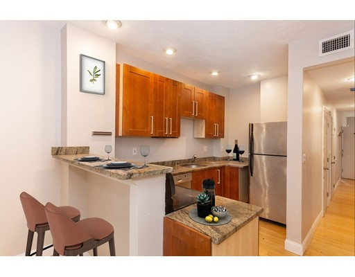 This renovated 2 bedroom, 2 bathroom brownstone condominium features two levels of living space,  located on a quiet dead end in Jamaica Plains's vibrant Hyde Square neighborhood. The main level of this unit offers an updated kitchen, formal dining/living room with refinished hardwood flooring and high ceilings, 2 newly carpeted bedrooms, a full bathroom, central air conditioning and in-unit laundry.  The lower level is an expansive master suite/potential 3rd bedroom or it could be used media room with ensuite bathroom. There is a private back deck off the kitchen and landscaped backyard. This property is located just a short distance to the Green Line, Orange Line & 39 Bus to Longwood Medical and Back Bay Station making it well suited for commuting, and is close to Whole Foods, Canary Square, Blue Nile, The Haven, The Frogmore, Tres Gatos, El Oriental, The Behan and many other local restaurants and shops.
