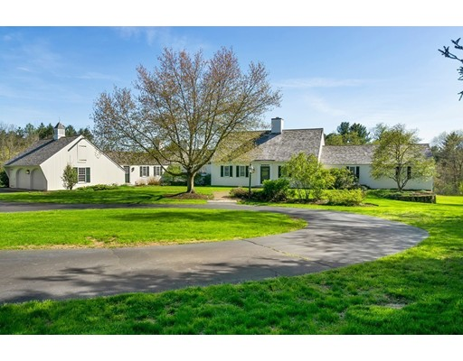 SIGNIFICANT PRICE ADJUSTMENT on this Charming Reproduction Estate featuring 5 BRs. Coveted South/Doherty district, around the corner to Pike, and less than 2 miles to Phillips Academy and Downtown! COMPARE - there is not a better value in Andover for 5.77 Acres of lovely PRIVATE land in a NEIGHBORHOOD w/town services. NEWER: Baths, Kitchen, Windows/Sliders, Heat, Cedar Roof, plumbing and more. Amazing Southern Wide Pine Floors throughout! 1st Floor Master suite offers marble bath & closets galore! 2 BR/ 2 BA on second floor. Separate suite offers flexibility for inlaw /aupair option. Family and friends will enjoy gathering around the Paneled FP in the huge Kitchen with 15' island, dining nook. SS appliances and Sub Zero. Adjacent Dining and Living Rooms (oversized FP) flow well for dinner parties. The highlight of the home is the Family Rm w/beamed cathedral ceiling,Radius window and massive FP- truly spectacular!Corner lot has room for a pool, ice rink, gardens. Peaceful & Special.