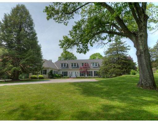 This private 14 acre estate is sited just across from the Dedham Country & Polo Club. The main residence offers an impressive front-to-back foyer, high ceilings, detailed moldings, and beautiful views from its east and west facing rooms. The master suite opens to tranquil gardens and offers built-ins, a dressing room and a marble bath. Upstairs there are three bedrooms and two baths. Outside, set within a circular stone wall, is the tranquil reflecting pool. There are long rolling lawns, wooded glades, and the library: a separate turn-of-the-century stone castle, featuring a wood paneled great room with soaring ceilings. Its hidden doors lead to interior rooms and a spiral staircase leads to the turret. There is a classic two bedroom cottage, two additional garages and the possibility of subdividing a lot. Conveniently located near top schools, commuter rail, great shopping and quick access to route 95, this is the place you'll want to come home to.