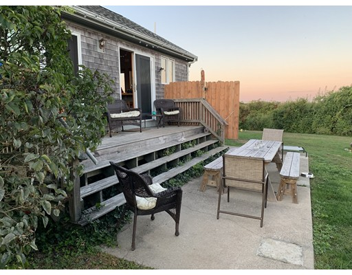This lovely cottage with ocean views was completely rebuilt in 2011. Surrounded by conserved land, this is a perfect place to have as a summer get away. With sliding glass doors along the back, open up the whole house and enjoy the ocean breeze. There is a walking path that takes you along the pond right to the beach.