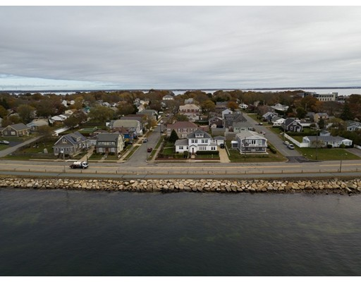 A lovely blend of antique charm and modern essentials. This lovely New England Colonial located at the end of the peninsula in New Bedford's far south end has spectacular water views of Clark's Cove. Updated for today's lifestyle while holding on to the feel of yesteryear. This 1920's beauty offers a great layout with hardwood floors throughout, a floor to ceiling fireplace with a grand stone façade, natural gas heat and gas stove, updated electric, updated roof, and siding, 1 car garage and a finished basement. Enjoy entertaining outside in the beautifully landscaped backyard with an in-ground heated pool. Minutes to highway, restaurants, parks, beaches, and library. The home is in a flood zone. Estimate from local agent: $1269