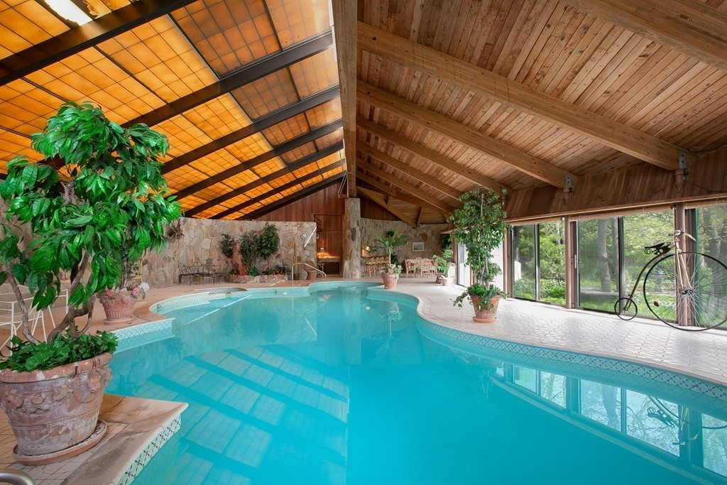 Stunning executive ranch w/indoor heated swimming pool is located in a highly sought after north end neighborhood of NB! NOW'S THE IDEAL TIME TO HAVE THE CONVENIENCE & SAFETY OF YOUR OWN PRIVATE SWIMMING POOL, WHETHER IT BE FOR PERSONAL PLEASURE, ENTERTAINMENT OR FITNESS! Imagine this 2832sq ft pool house with 18' high ceilings, Maine cedarwood and Connecticut stone interior, bar/lounge/kitchen/sunroom area, consecutive sliding doors that open up to your very own backyard oasis! This unique property offers 3 bdrms/4 ba, has frontage on 2 streets...faces Jarry St & sprawls all the way back to Maryland! The dramatic kitchen design with its steep skillion roofline and plethora of full length windows, brings in natural sunlight & creates the feeling of being embraced by the tropical gardens! Sunken living room w/fieldstone fireplace! Finished basement w/kitchen & full bath has a fun atmosphere, great for a family room, music/video room or ideal for in-law setup!! VIEW THE 3D VIRTUAL TOUR
