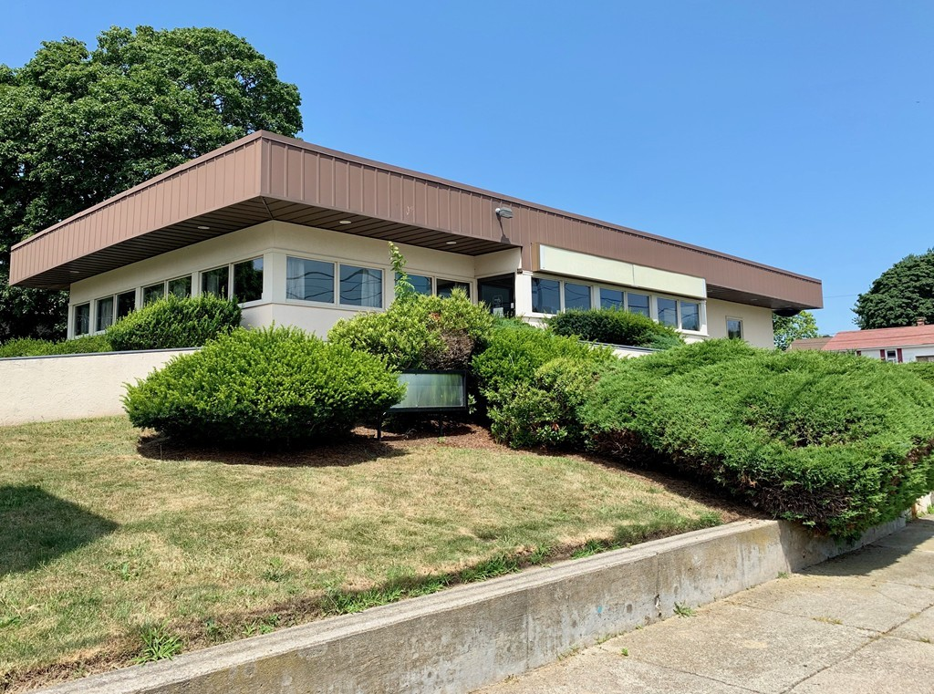 Available for purchase, lease, or lease to own! Former credit union, centrally located in a growing area of Fall River, with easy access to Rte's 24 &195. Easy access via frontage on Reeves (181.4'), Cambridge (100.35') and Somerset (103.18'), with parking for 16 cars and a drive-through lane on the westerly side of the building. The building is currently permitted for use as a bank/credit union, and offers waiting area, teller stations, offices, and vault. Other potential conversion possibilities are medical, general or service offices (with approval) or even residential use. Bonus - basement is 90% finished, creating even more usable space.  This is a great opportunity to start or move your business, as owners are open to leasing the property at $2,500/month (triple net) and are also open to a lease-to-own arrangement.