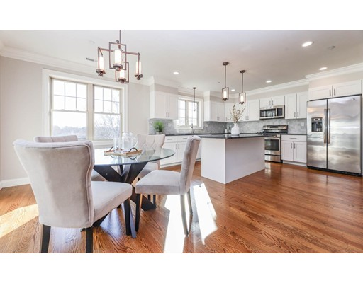 Set on Historic Fort Hill, this two-level Townhouse style unit was built in 2015 with tasteful finishes throughout. Superb location with easy access to the medical area and downtown. Spacious floor plan that includes a living room with wainscoting, gas fireplace in dining, large kitchen with center island that has quartz counters and stainless appliances, balcony off kitchen/dining. The second level is two bedrooms with a common hall bath and a large master suite with a private tiled bath and walk-in closet. Multi-zone efficient heating and cooling, central vac, alarm system, private storage, and garage parking. Freshly refinished floors and paint, totally turn-key/move-in ready.