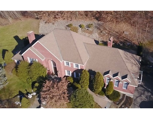 """Bring your checkbook as this won't last! Priced under assessed value! We have left the updates to a new owner with this unmatched location! This luxurious home is perched on a corner lot in the beautiful Bear Hill North Andover neighborhood! This spacious estate like home has an open floor plan and features 16 rooms with 7 bathrooms! The over-sized eat-in kitchen is wonderfully equipped with a double wall oven, center in-ground island, and granite counter tops perfect to the inner chef in everyone. It expands to the family room which also connects to the over-sized Cathedral Ceiling Great Room with a double sided fireplace. The home also boasts both first floor and second floor ensuite master bedrooms! Enjoy your spacious finished lower level with bath! This home comes fully equipped with an irrigation system and back up generator to keep you warm and protected in the rare event that the power were to go out. Home is being """"SOLD AS IS""""."""