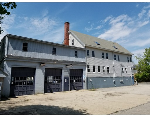 Attention Developers! An approx 10,000SF Down Town building on .27 acres is a possible development project for residential/mix use apartments/condos - similar project in planing near-by.  Zoned Ashland Down Town District C which allows for multiple uses including res/comm/mixed. Additional adjacent 2-family may also be available (.5 acre total). Building/Land has multiple possibilities. Three story 30'x60' main building currently configured for office space with plenty of future expansion possibilities. Plus an attached 30x45 shop/manufacturing space (1350sf) with 3 high bay garages. Basement of main building is also set up as 1800sf shop/mfg space with garage door access. Both spaces perfect for mechanic, autobody shop, light manufacturing. Plenty of paved parking. About half the main 30'x60' building (5400sf over 3 levels) consists of 4 office spaces with the remaining half being open, un-finished, and suitable for office, warehouse, residential re-fit. See also MLS 72607601