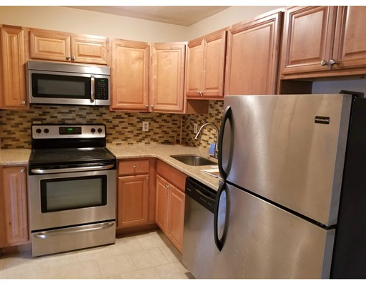 Ready now!   First floor unit with updated kitchen and bath.   Large living room, deeded parking, laundry in building.     End unit in Quiet Complex.   Close to Shopping , Highways etc. On Bus Line to Boston.