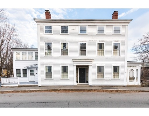 A unique opportunity to own an important piece of Marblehead history. Live within walking distance of shops and restaurants, Crocker Park, and Fort Sewall, with no compromise on space and parking.  This historic property features 8 bedrooms on the 2nd floor and 6 additional rooms on the 3rd floor with a total of 4 1/2 baths.  Warm up in front of one of the four fireplaces, picture dinner in a formal dining room or relax on one of two beautiful sun porches.  High ceilings on the first and second floors and hardwood in most rooms.  Thoughtfully maintained with two newer heating systems and an attached 2-car garage.  The enormous backyard provides plenty of options for todays active lifestyle including a separate 2-car garage/barn and storage shed. Use your imagination to restore this graceful home to its original grandeur.  This property is comprised of two lots and are being sold together.