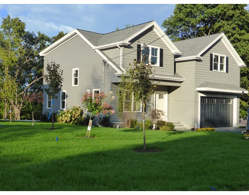 Enticing newly constructed home is energy efficient w/a Home Energy Rating of 49! Stunning kitchen with over-sized island that provides excellent storage capacity.  Enjoy fresh air on the main level deck or the patio underneath. A complete suite hosts guests, teens or au pair in the lower level. Mudroom with custom cabinetry including wine racks offers convenience and organization. The master suite is a sumptuous and spacious retreat.Two other upstairs bedrooms offer generous proportions. Lovely views  - even including from the laundry room! Two car garage, three zone heat & A/C, hardwood, tile & laminate flooring. Engineered quartz and granite counter/vanity tops.  Decorative and recessed and under counter lighting.  Thermador appliances. Split staircase. Welcoming foyer. 9' ceilings with rich crown moulding. Covered front porch.  Lush landscaping w/underground sprinkler system. Walk to schools, recreation, shops, post office, commuter transportation. Floor Plans attached in documents