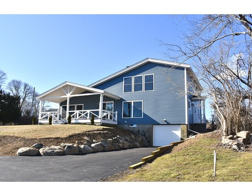 """This unique property with water views is located within walking distance to Round Hill Beach,this home is a perfect year round home or a vacation getaway.1st floor features a large bright great room with soaring ceilings, a grand floor to ceiling fireplace with artifacts from """"The Wanderer"""" the last whaling ship to leave New Bedford in 1924.Artifacts from the Charles W. Morgan are also found in the home.New eat-in Kitchen with stainless steel appliances and stone counters, adjacent to the kitchen is a laundry room. The den/bedroom and full bathroom completes the first floor. 2nd floor has two bedrooms. The large master suite has its own private bathroom, gleaming hardwood floors, and cathedral ceilings with oversized windows that capture the water views.The covered porch is a highlight to this home perfect for your morning coffee and taking in the views of the Round Hill Community golf course.The home has been upgraded with new roof, exterior siding, furnace, windows, kitchen and Baths"""