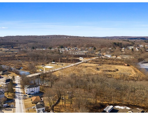 Well located 16.2 Acre mixed use development site located in the Fisherville Mill Overlay 40R district. Up to 180 units of residential apartments or condos with 60,000SF of commercial space allowed. Mostly cleared, level, picturesque site with 840+/- feet of frontage on Route 122A in South Grafton. Water, Sewer, natural gas and electricity available at the street. Great suburban location but not far from shopping and transportation. Just a short ride to the MBTA commuter rail station.