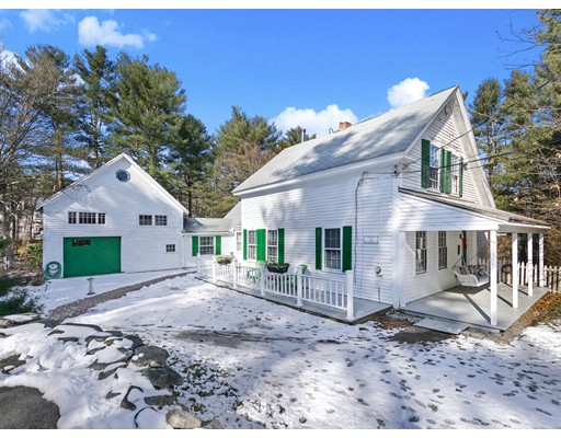 This quintessential New England farmhouse, built in 1850 oozes of charm!  From the moment you arrive, you will be enamored with the front and side farmers' porches, small courtyard, and details from a bygone era.  The home is warm, inviting, and filled with sun and character.  The heart of the home is the large county kitchen with a walk-in pantry, induction cooktop, functional design and easy access to the family room with built-ins.  The house boasts an open concept living room with fireplace and dining room, a versatile floor plan allows for a first-floor bedroom, studio space over the carriage house with a wood pellet stove, private heated workshop with its own entrance, large rear deck and a private beautiful yard filled with perennial gardens and lawn.  This home is where you will want your history to take place, you will love it as much as the current owners do too!
