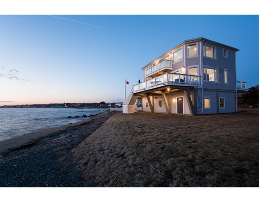 This waterfront estate, beautifully sited on the Fairhaven Shore, overlooks scenic Buzzards Bay with expansive views of the harbor, Cuttyhunk & Martha's Vineyard. This Beautifully designed and artfully crafted custom contemporary waterfront home offers pristine and picturesque Waterview's from every room and it comes with its own private beach.  The second floor Bayview master suite and guest suite directly accesses the expensive wraparound deck. Immersed in natural light this home offers three bedrooms, two bathrooms and many Amenities making this luxury home the envy of your neighbors with a gourmet kitchen offering granite countertops and stainless steel appliances, irrigation system, Bose surround sound speakers, alarm system, perimeter lighting, outside hot and cold shower, Specialty stamped concrete circular drive & Trek decking and so much more.