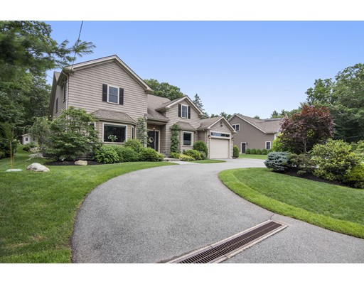Prestigious, Private, and Oasis describe this Custom built Colonial home tucked away in the heart of the Lanes of Waltham. This home boasts an amazing floor plan with plenty of room to entertain the largest of families. No stairs needed to walk into your oversized  first floor master bedroom with walk in closet and master bath with access to your deck. The second floor offers three spacious bedrooms and a full bathroom. The kitchen offers a Viking stove and plenty of counter space with peninsula, with views of the dining room with vaulted ceilings and separate sitting and wet bar area for drinks prior to dinner. As dinner winds down feel free to enjoy the fireplaced family room with lots of windows to view your magnificent property with beautiful walls and plantings with accent lighting, walkways, patio and deck!  The lower level is fully equipped with conditioned wine cellar,  a full bathroom, a bar and pool table area, a media lounge area and a workout area!