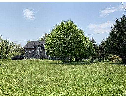 Looking for Privacy, this home is Like no other! This Secluded Westport Farm is tucked away and set up high on a Picturesque lot overlooking its 12 stall horse barn surrounded by gorgeous cornfields and woods. The house has room to roam with a full bath on all three levels, Easy Airbnb ? Offering 4-5 Bedrooms. It has all the Charm you could ask for, period details, hand painted wall murals, antique hardwoods, wood burning fireplace, Built in hutches, draws, storage areas & lots of closet space. The Rustic Kitchen is nice with wooden counter tops, white wash pine walls & neat hexagon windows.The First Floor Bedroom, has a huge walk in closet! Formal dining room & Double parlors with picturesque views. Plus you'll find 3 More Bedrooms, a Full Bath & a bonus room upstairs. Outside there are 2 Outbuildings & a Large Horse Barn. A homesteaders dream. Easy drive to local beaches. Potential for additional land to lease for Farm use.