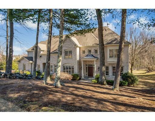 Located in the desirable Woodland Preserve neighborhood, this elegant brick front colonial is ready for new owners. The 2-story foyer drenched in sunlight invites you into a first floor featuring an open concept design. The casual elegance of this home lends itself to comfortable living and grand entertaining with a chef's kitchen, wet bar and great room. Attention to detail is evident throughout, with hardwood floor inlays, wainscoting and intricate crown molding. A 3-season porch and mahogany deck overlook the private backyard and offer a space to relax on a quiet evening. The second floor features a luxurious master suite with 2 walk-in closets, a second en suite bedroom and 2 additional spacious bedrooms. Escape for a movie night in the 3rd floor media room or head downstairs to the walk-out finished lower level, which boasts the 5th bedroom, full bath and game room. Easy access to  trails, 495, Mass Pike and commuter rail.