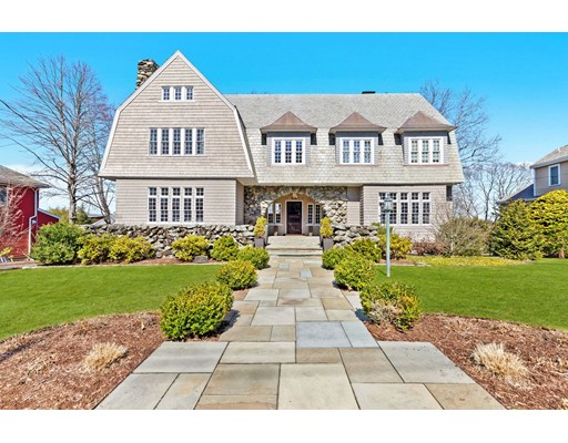 """Chestnut Hill gem. Situated on a tree lined street is this beautiful 4,521 sq. ft. slate gambrel roof shingle style home with significant stone arches. The stunning foyer leads you to an  incredible chefs kitchen renovated in 2015 featuring custom cabinetry, top of the line appliances, over sized island with gorgeous Quartzite counters leading to a huge mahogany deck with spectacular views of the yard & city both w/surround sound. Elegant dining room & living room both with fireplaces & beamed ceilings. Wonderful pantry & gorgeous powder room (2017).The second floor boasts a master suite with walk in closet and full bath flanked by 3 additional bedrooms, full bath & a family room. Third floor guest bedroom, full marble bath & game room. Lower level mudroom & laundry room renovated in 2015. Insulation sprayed into walls in 2018. Heated driveway, 2-car direct entry garage built in 2015. Central A/C, Minutes to Baker School, local shops, """"The Street"""", bus stop and hospitals."""