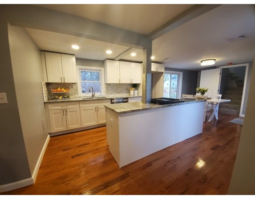 Are you looking for island living with modern amenities? This beautifully finished cottage is nicely situated on Fairhaven's hidden gem, West Island! This home features many views of the glistening waters of Buzzards Bay. This stunning home features 3 generously sized bedrooms, as well as a large bonus room! You will be amazed at this homes endless modern updates including its brand new kitchen with stainless steel appliances and granite countertops. There are also beautiful new hardwood floors and recessed lighting all throughout the entire home. You can also marvel on the brand new roof, windows, siding, insulation, plumbing, electrical, water main, and central heating and air conditioning system on propane gas to make the home best suitable for both winter and summer conditions. This home is turnkey and waiting for its new owners to fall in love! Additional space is available on the second floor. Property is officially deemed not in a flood zone. Deeded rights to West Island Beach.