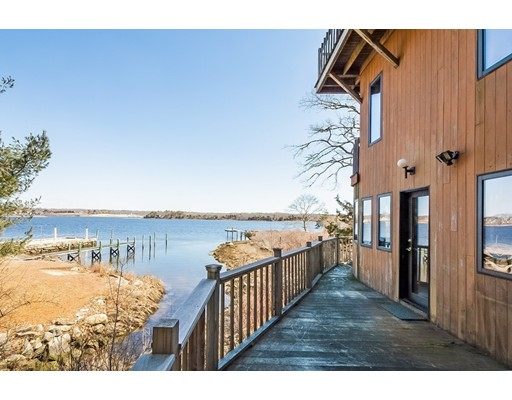 WESTPORT RIVERFRONT HOME -  This house hosts picturesque water views from all 3 levels!  It sits on the western bank of the Noquochoke (East) Branch of the Westport River.  Here's your chance to fish for trout in your own brook, watch water fowl swim or fly by from your own mahogany deck, go fishing, shellfishing, canoeing, kayaking, or sailing in your own backyard.  Keep a boat on your own shared dock or on a mooring out front.  This 3 bedroom, 2 bath Contemporary has a completely open floor plan on the first level which allows you to see the water no mater where you stand.  Your 2.26 acres are nestled into a very desirable part of Town.  Great place to write or read a book!  Fall asleep and wake up listening to the nearby babbling brook with 2 waterfalls. Home has maple floors throughout with a central vacuuming system.  What a place to call home!