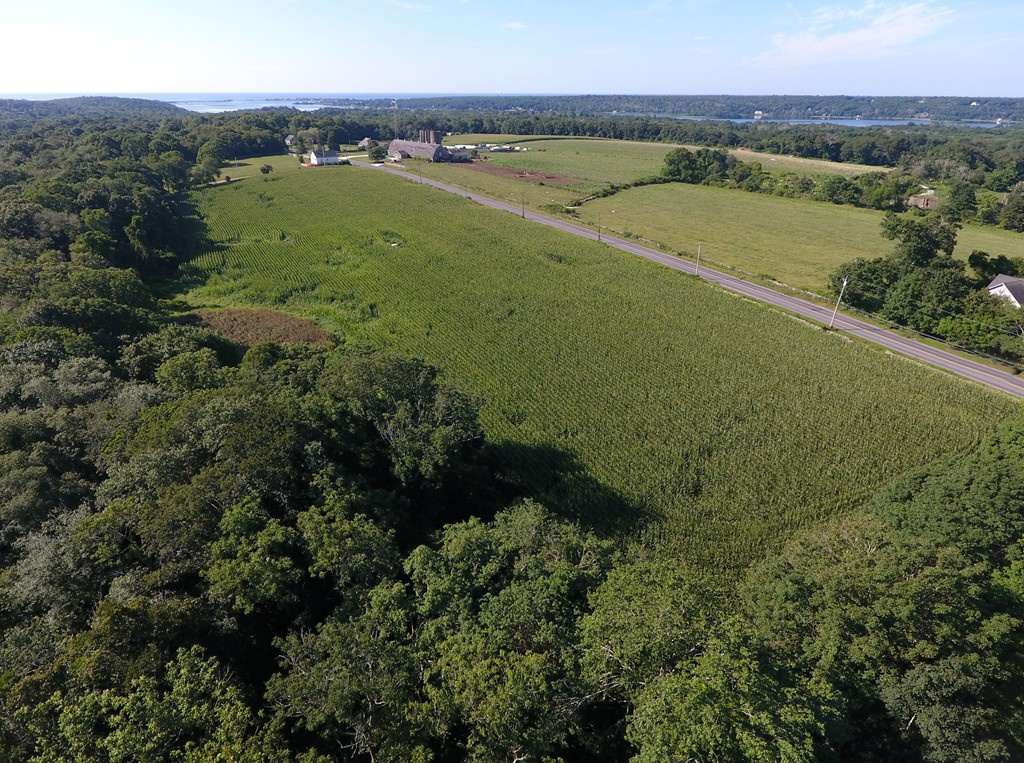 NEW LOT on lower Main Road.  New 1.49 acre parcel in bucolic setting beckons.  172.09 feet of road frontage. Percs are done.  Lot is mostly upland.  Seller will require underground utilities.  Natural gas nearby.  No design review or restrictive covenants.  Not far from Westport Point, gorgeous ocean beaches, marina, restaurants, walking trails!