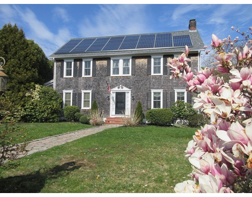 Spring into action and come take a close look at this Classic New England Colonial tucked away in  Padanaram Village.  Relax this summer by enjoying all the area's fine amenities including the Nation's #1 harbor,  swimming, fishing, boating, recreational activities, restaurants, village shops and much more!  Low interest rates makes this the perfect time to purchase a home!  This antique home was the former Lawrence Grocery Store located on Elm St. in the 1900's.  Relocated to it's present location in 1978, this property is a timeless piece of Dartmouth history for one to own! With professionally manicured grounds, this home graces the corner of Bridge/N. Pleasant St. It offers 4 spacious bedrooms with high ceilings,1.5 baths, partially finished basement, a lovely 20' x 26' trex deck with 6 person jacuzzi, an enclosed yard, and 2 car garage.  The location is superior and is awaiting it's new owners!!! Property is easy to show.