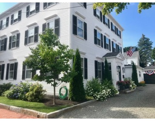 Steps away from the Famous Newburyport downtown Waterfront, this 7 room/4 bedroom/2 full/1 3/4  baths townhouse is a jewel! Two words describe this gorgeous property: immaculate & pristine.  Certainly a rare townhouse find--from a spectacular private backyard along with an extra-large one car garage upgraded w/ CA closet storage; this one is a keeper. Equipped with high-performance appliances and comfort such as, but not limited to: stainless steal Sub Zero fridge, 6 burner Wolfe Oven system, and an eat-in-kitchen w/ gas fireplace that will bring out the master chef inside you! Spacious master suite includes radiant master bathroom marble flooring paired with exquisite woodwork detailing that extends throughout the entire home. Abundant sunlight pouring into each room, this is the perfect place to raise a family, entertain, work from home; there are just so many options. Take advantage of this spectacular home, remodeled just 7 short years ago & freshly painted exterior painted 1yr ago