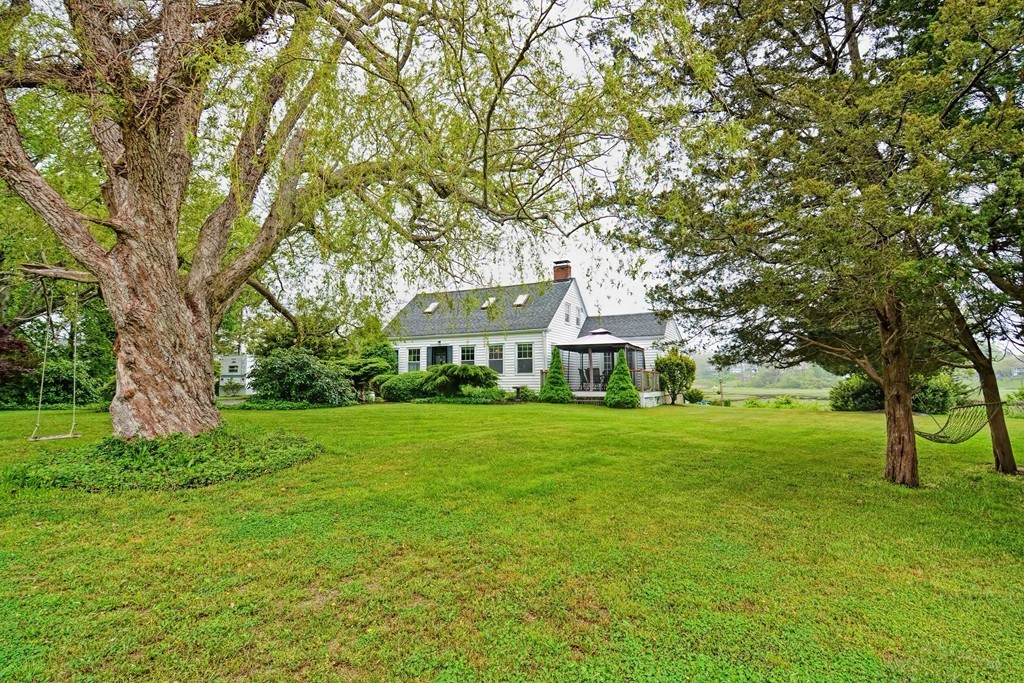Welcome to Cape Cod! First showing at Open House 5/31 12-1:30pm *All parties must wear mask and gloves to enter home*. Well maintained, private, charming 3 bedroom, 1 full bath, Cape Style home, offers peace and serenity water views of Mills Creek and Sunsets & Sunrises of Sandwich Bay. Roughly 50ft from the back patio to the creek water allows easy access for non motorized water sports. Living room and Kitchen are open concept, large sunroom has skylights and plenty of windows for a great view of the water . Bedroom down stairs has its own stand up shower, with access to outdoor deck. 3/4 acre of beautiful landscaped yard with some fruit trees. A small 4 room cottage can be used as is or turned into cabana or outdoor bar for entertaining. 2 car detached garage. Brand new furnace, newly oil tank. 5 miles from the Cape Cod Canal with many great restaurants and grocery markets, easy access to major highways. 1/2 mile from the Beach and Sandwich Boardwalk. Potential to build equity!