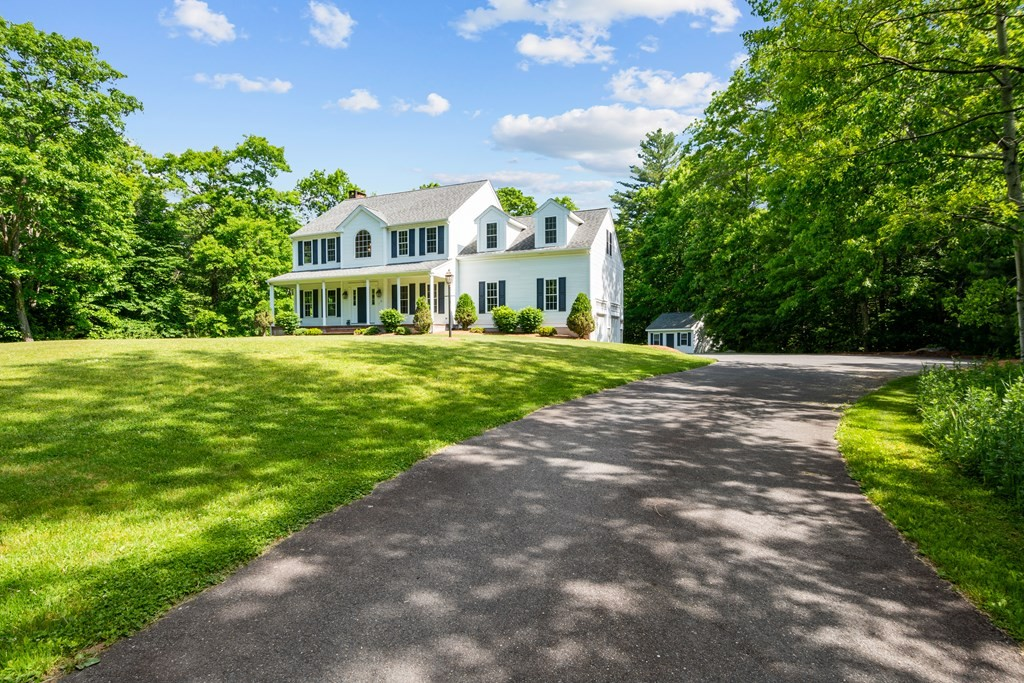 This is exactly what you have been waiting for! This incredible home is nestled 300'+ off the road on over 4 acres of private and well manicured grounds on Hunt Drive; a beautiful and established North Rehoboth cul de sac neighborhood. Spacious and bright with over 2,700 square feet of true above grade living space and 4 generous sized bedrooms. Many recent updates! You will be the first to use the new custom kitchen as it was completely renovated May 2020!  Features include: new cabinetry, gorgeous Quartz counters and brand new stainless steel appliances. The family room features a beautiful floor to ceiling stone wood burning fireplace and gleaming hardwoods. All interior walls and trim have been freshly painted! All new wall to wall carpeting in the bedrooms. Central air, storage shed, security system,low maintenance vinyl exterior, tall 9's ceilings and hardwood flooring throughout first floor. The unfinished walkout basement gives you potential future living space!Absolute Beauty!
