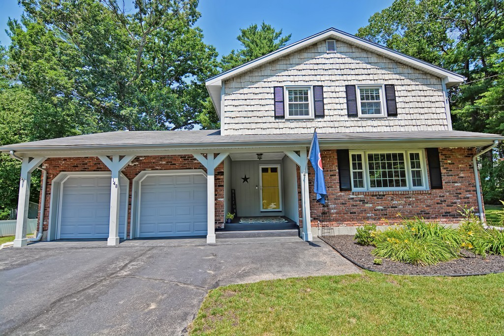 This Custom Colonial is located on a corner lot of a quiet, well-established neighborhood! There is no doubt that this is a comfortable home. The house features a unique and spacious floor plan with ample room for entertaining or a large family. Two ductless mini-split AC/Heat units on the first floor and one in each of the 4 bedrooms on the second floor! The first floor features hardwood floors, a wood burning fireplace, formal living and dining room, eat-in kitchen, half bath, and slider opening out to the large deck. The second floor features a large landing at the top of the stairs with a full bathroom, 4 bedrooms and a master bath! This home has been meticulously cared for and the neighborhood is great for walking and conveniently located for commutes to Boston or Providence.