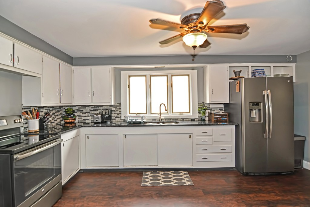 Move in ready ranch with updated kitchen. Hardwood floors in living room and bedrooms. Home is located on a corner lot for more privacy and within quiet neighborhood. Attached garage leading to three season room. Schedule your tour today!