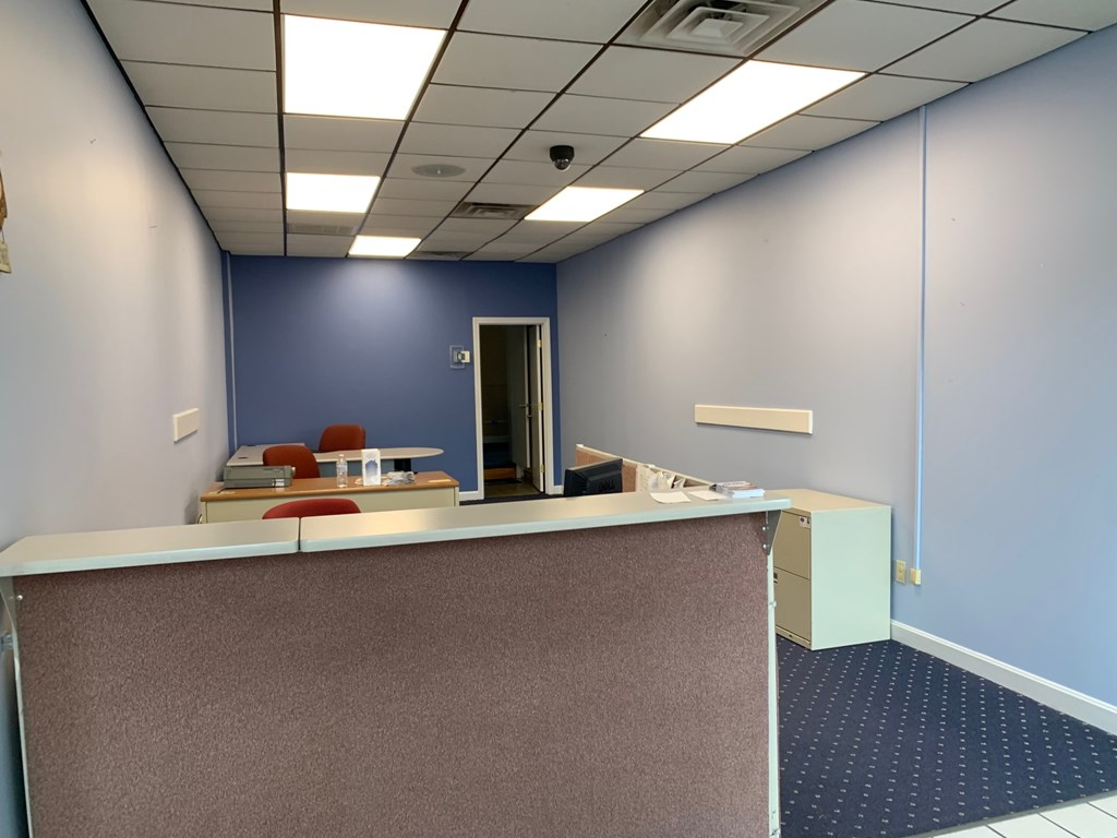 Furnished Office Space with desk, chairs and phones. Parking available. Utilities and building services not included.